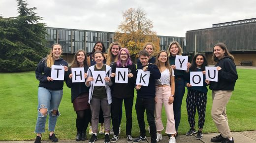 Students holding a thank you banner